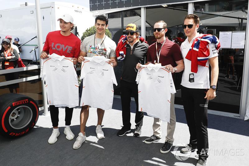 Fernando Alonso, McLaren, and Stoffel Vandoorne, McLaren, meet players from the Montreal Canadiens NHL Ice Hokey Team