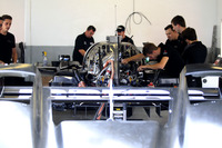 Crew memner working on the car of #55 Mazda Team Joest Mazda DPi: René Rast, Oliver Jarvis,