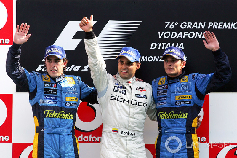 Podium: second place Fernando Alonso, Renault, third place Giancarlo Fisichella, Renault and race winner Juan Pablo Montoya, McLaren