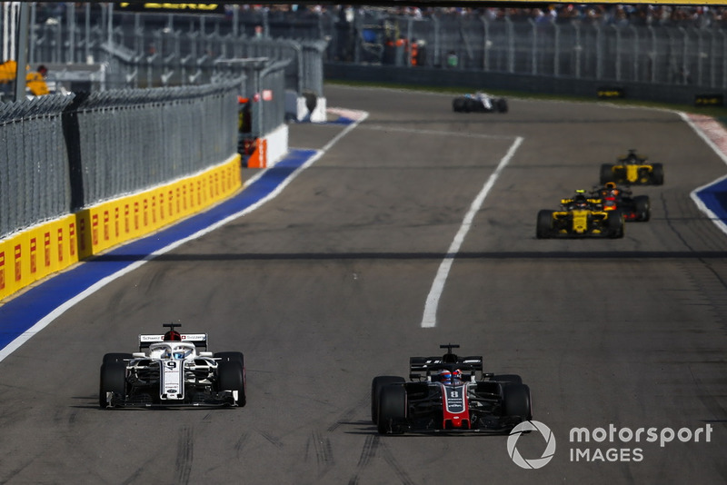 Romain Grosjean, Haas F1 Team VF-18 and Marcus Ericsson, Sauber C37