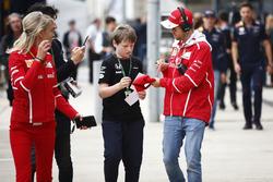 Sebastian Vettel, Ferrari, signs an autograph for a young fan