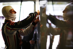 Romain Grosjean, Haas F1 Team, puts on his balaclava in the team's garage