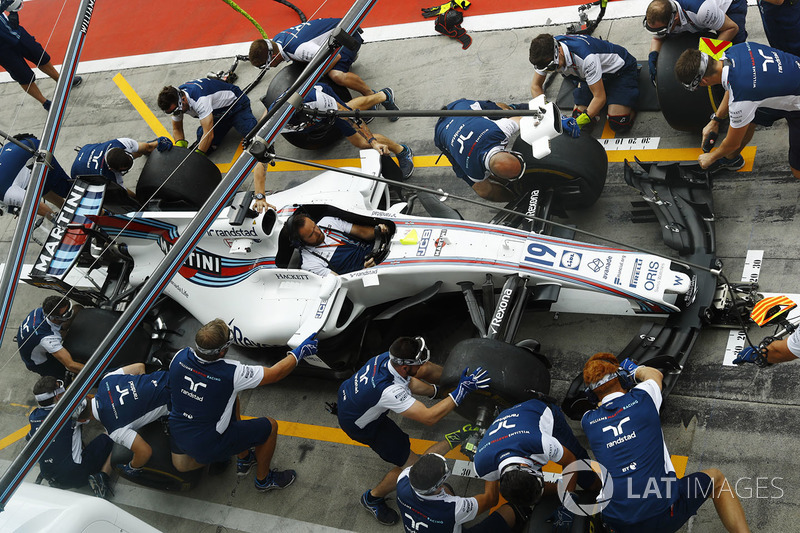 The Williams team conducts a practice pit stop