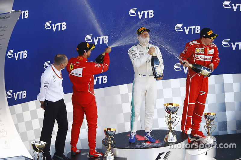 Second place Sebastian Vettel, Ferrari, Race winner Third place Valtteri Bottas, Mercedes AMG F1 Kimi Raikkonen, Ferrari, celebrate