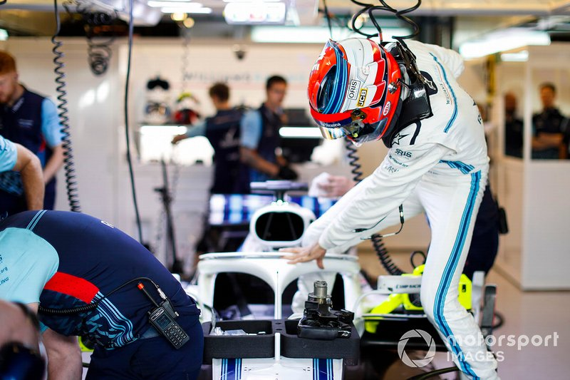 Robert Kubica, Williams Martini Racing, enters his cockpit in the team's garage
