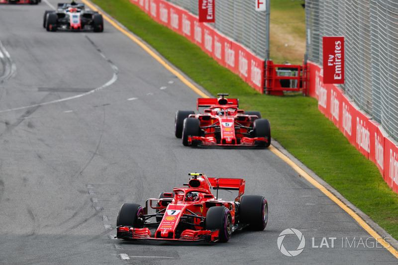 Kimi Raikkonen, Ferrari SF71H, leads Sebastian Vettel, Ferrari SF71H, and Kevin Magnussen, Haas F1 T