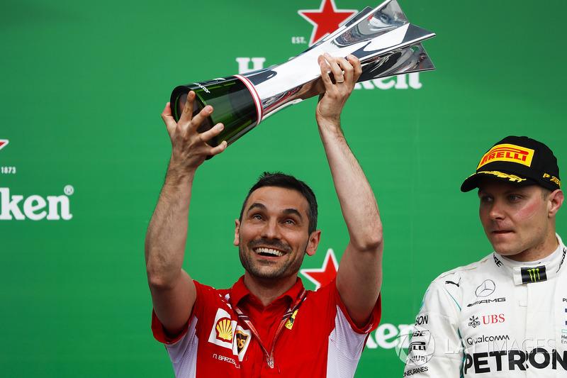 Nicola Bariselli, Race Engineer, Ferrari, lifts the constructors trophy alongside Valtteri Bottas, M