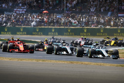 Valtteri Bottas, Mercedes AMG F1 W09, leads Lewis Hamilton, Mercedes AMG F1 W09, Kimi Raikkonen, Ferrari SF71H, and the rest of the field at the start of the race