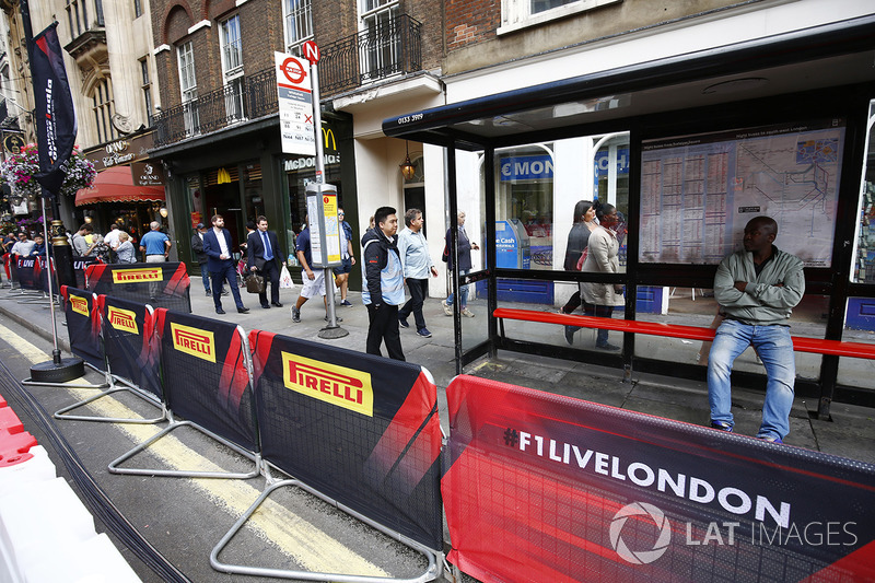 A bus stop in Whitehall is cordoned off by barriers for the F1 Live street demonstration parade