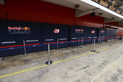 The Red Bull Racing team's garage is barricaded from onlookers by protective screens