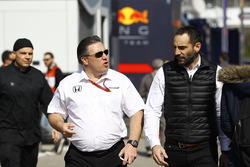 Zak Brown, Executive Director of McLaren Technology Group, talks to Cyril Abiteboul, Managing Director, Renault Sport F1 Team, in the paddock