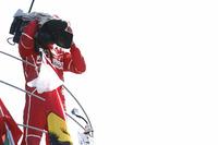 Third place Sebastian Vettel, Ferrari, borrows a TV camera to film the crowd from the podium