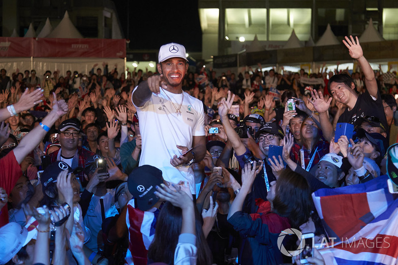 Lewis Hamilton, Mercedes AMG F1, joins a huge gathering of fans