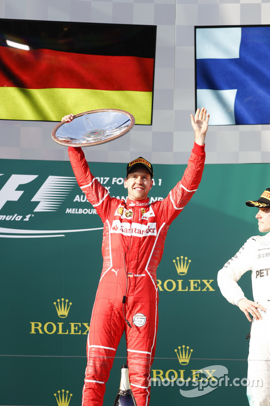 Sebastian Vettel, Ferrari, 1st Position, celebrates victory on the podium with his trophy