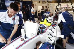 Mechanics are working on the car of Felipe Massa, Williams FW40