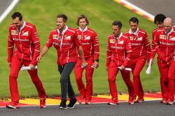 Sebastian Vettel, Riccardo Ferrari walks the track, Adami, Ferrari Race Engineer, Jock Clear, Ferrari Chief Engineer, trainer Antti Kontsas, the team