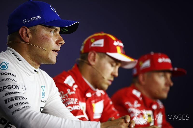 Прес-конференція: володар поул-позиції Себастьян Феттель, Ferrari, друге місце Кімі Райкконен, Ferra