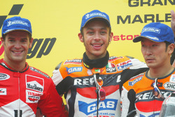 Podium: Race winner Valentino Rossi, Repsol Honda Team; second place Carlos Checa, Marlboro Yamaha Team; third place Tohru Ukawa, Repsol Honda Team