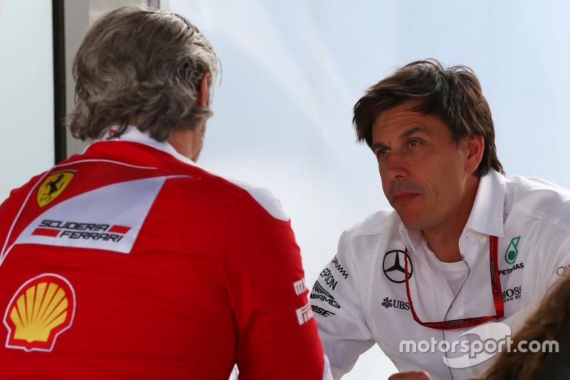 (L to R): Maurizio Arrivabene, Ferrari Team Principal with Toto Wolff, Mercedes AMG F1 Shareholder a
