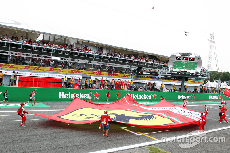Ferrari fans invade the circuit at the end of the race