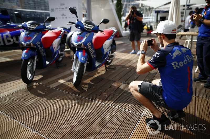 Pierre Gasly, Toro Rosso, takes a picture of Honda motorcycles