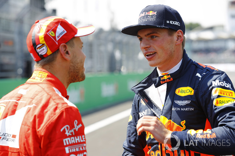 Pole winner Sebastian Vettel, Ferrari, talks to second place Max Verstappen, Red Bull Racing