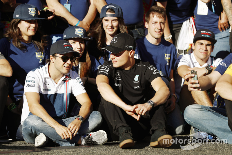 Felipe Massa, Williams, talks to Valtteri Bottas, Mercedes AMG F1, at the FIA Volunteers Day celebrations