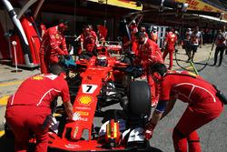 Kimi Raikkonen, Ferrari SF70H, is returned to the garage