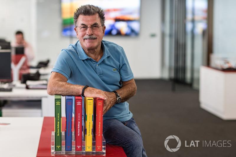 Rainer W. Schlegelmilch poses in the Motorsport Network office