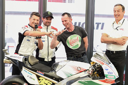 Lucio Cecchinello, Team LCR Honda Team Principal, Aaron Slight compare fingers,