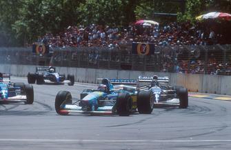 Michael Schumacher, Benetton B194 leads with Damon Hill, Williams FW16B