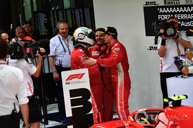 Sebastian Vettel, Ferrari et Kimi Raikkonen, Ferrari dans le Parc Fermé