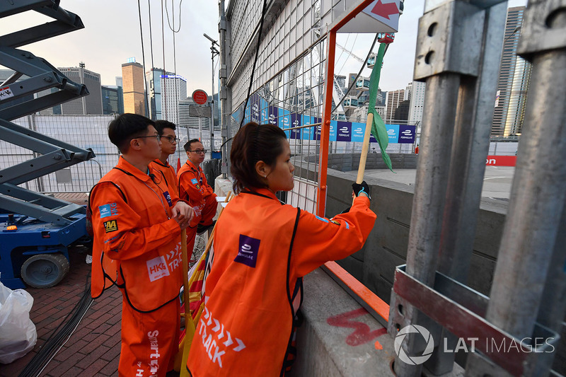 Marshals wave a green flag