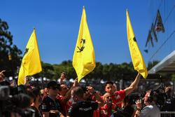 Ferrari flags and mechanics at the podium celebrations in