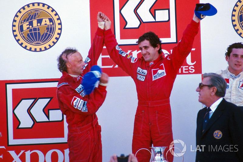 Podium: race winner Alain Prost, second place Niki Lauda, third place Ayrton Senna