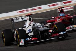 Kamui Kobayashi, Sauber C31, leads Fernando Alonso, Ferrari F2012