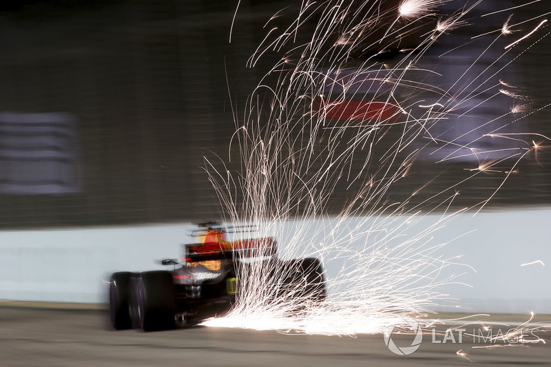 1. Sparks pour from the rear of Daniel Ricciardo, Red Bull Racing RB13