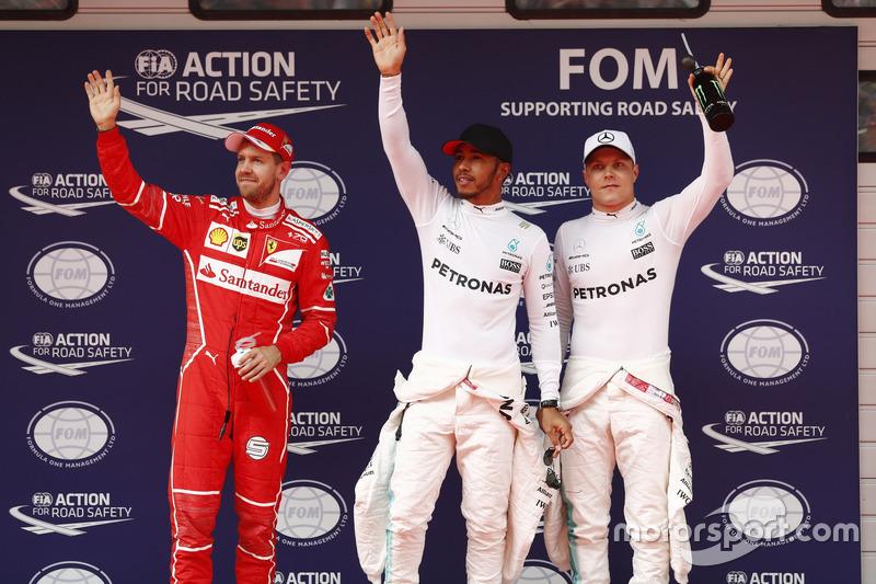 Qualifiche Top 3: Lewis Hamilton, Mercedes AMG, Sebastian Vettel, Ferrari, e Valtteri Bottas, Merced