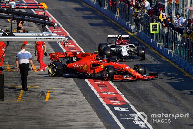 Charles Leclerc, Ferrari SF90, leaves the garage ahead of Kimi Raikkonen, Alfa Romeo Racing C38