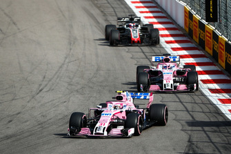 Esteban Ocon, Racing Point Force India VJM11, leads Sergio Perez, Racing Point Force India VJM11, and Romain Grosjean, Haas F1 Team VF-18