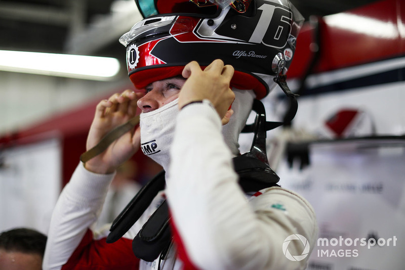 Charles Leclerc, Sauber, puts on his helmet.