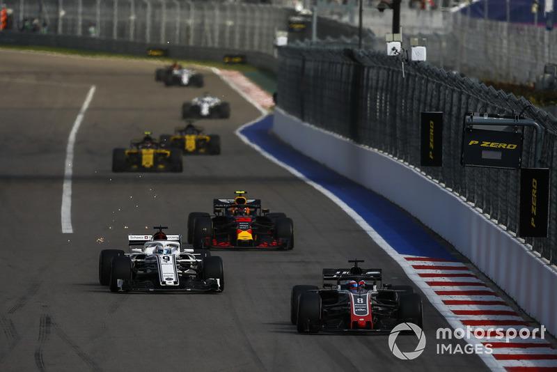 Romain Grosjean, Haas F1 Team VF-18 leads Marcus Ericsson, Sauber C37