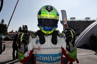 Benito Guerra celebrates after winning a race