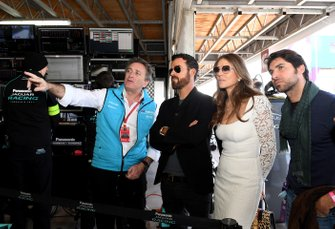Alejandro Agag, CEO, Formula E, gives Actors Elizabeth Hurley, Justin Theroux, Bullfighter Cayetano Rivera Ordóñez a tour of the garages
