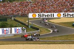 Damon Hill, Arrows A18, Eddie Irvine, Ferrari F310B, Mika Hakkinen, McLaren MP4/12