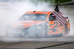 Brad Keselowski, Team Penske Ford, celebrates with a burnout after winning