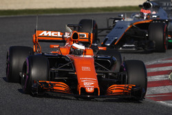 Stoffel Vandoorne, McLaren MCL32, leads Esteban Ocon, Force India VJM10