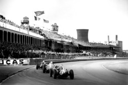 Maurice Trintignant, Cooper T51-Climax, leads Stirling Moss, BRM P25, and Bruce McLaren, Cooper T45-Climax