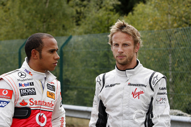 Jenson Button, Brawn GP BGP001 Mercedes, Lewis Hamilton, McLaren MP4-24 Mercedes after their collision at Les Combes on the first lap of the race