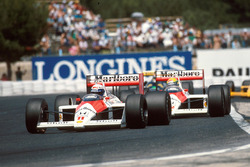 Alain Prost, McLaren MP4/4,  leads his teammate Ayrton Senna, McLaren MP4/4